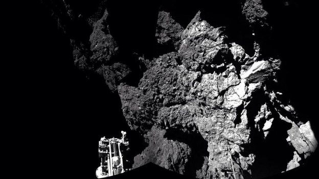 The robotic probe, named Philae, as photographed by the orbiting rocket that carried Philae to the comet